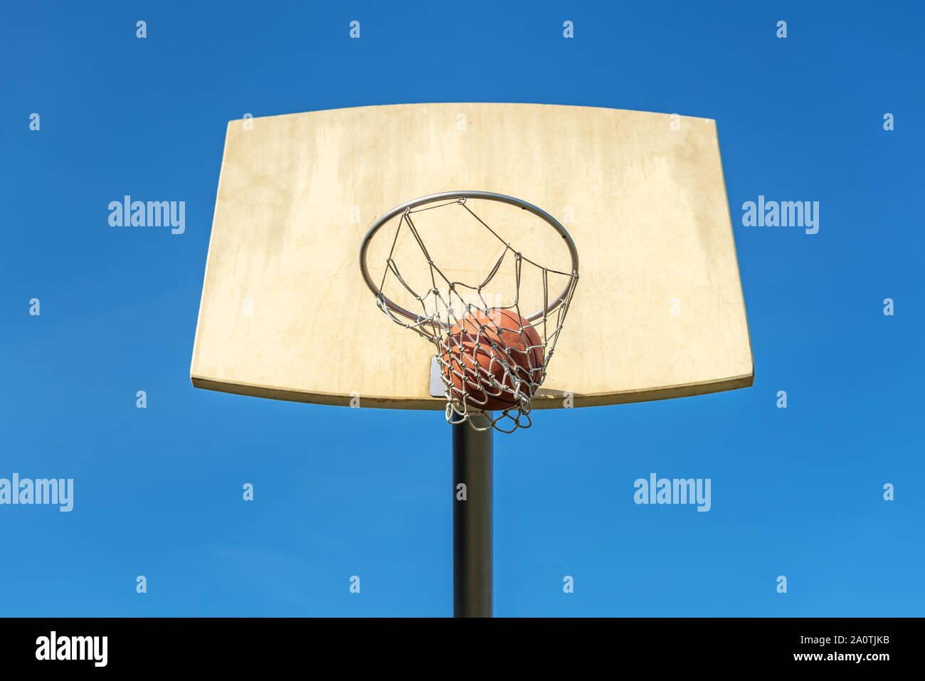 Basketball flies into the basketball ring. Stock Photo