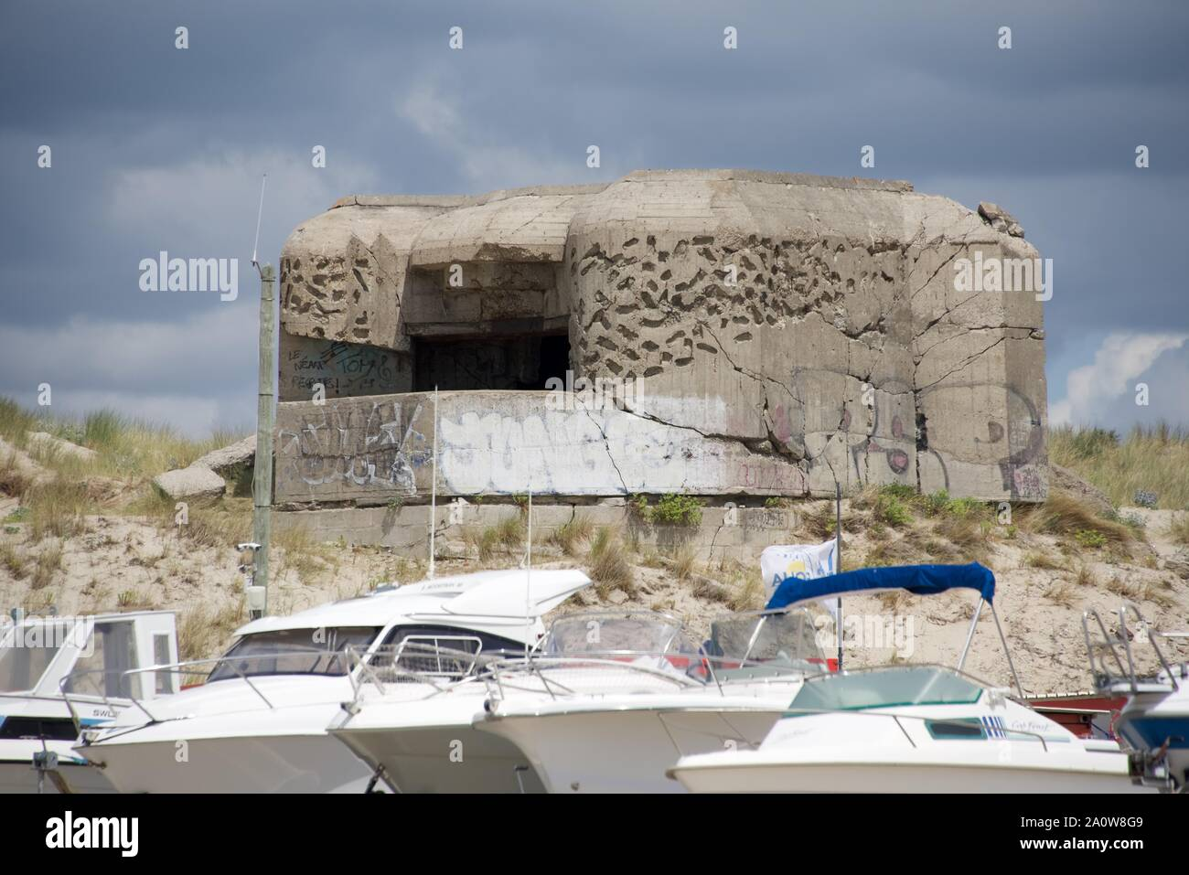 Pill box, or gun implacement, one of many concrete bunkers built by the Germans to defend the coast line of France from allied invasion Stock Photo