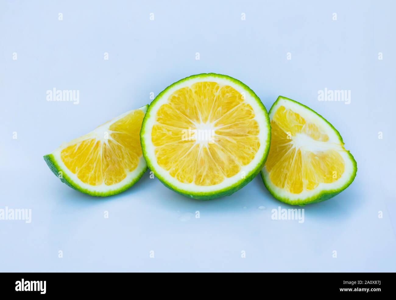 close up of green orange slices isolated on white background. Stock Photo