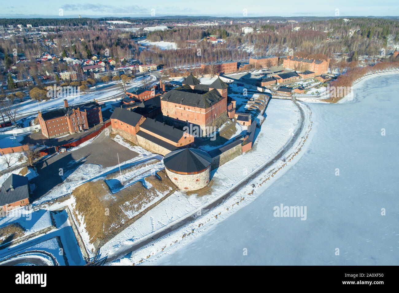 Above the ancient fortress of the city of Hameenlinna on a sunny March day (aerial photography). Finland Stock Photo