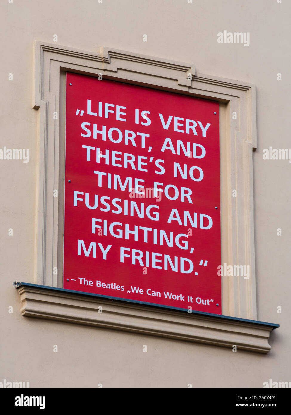"""Beatles """"life is very short..."""" song lyrics on display board in the Museums Quarter of Vienna, Austria. Stock Photo"""
