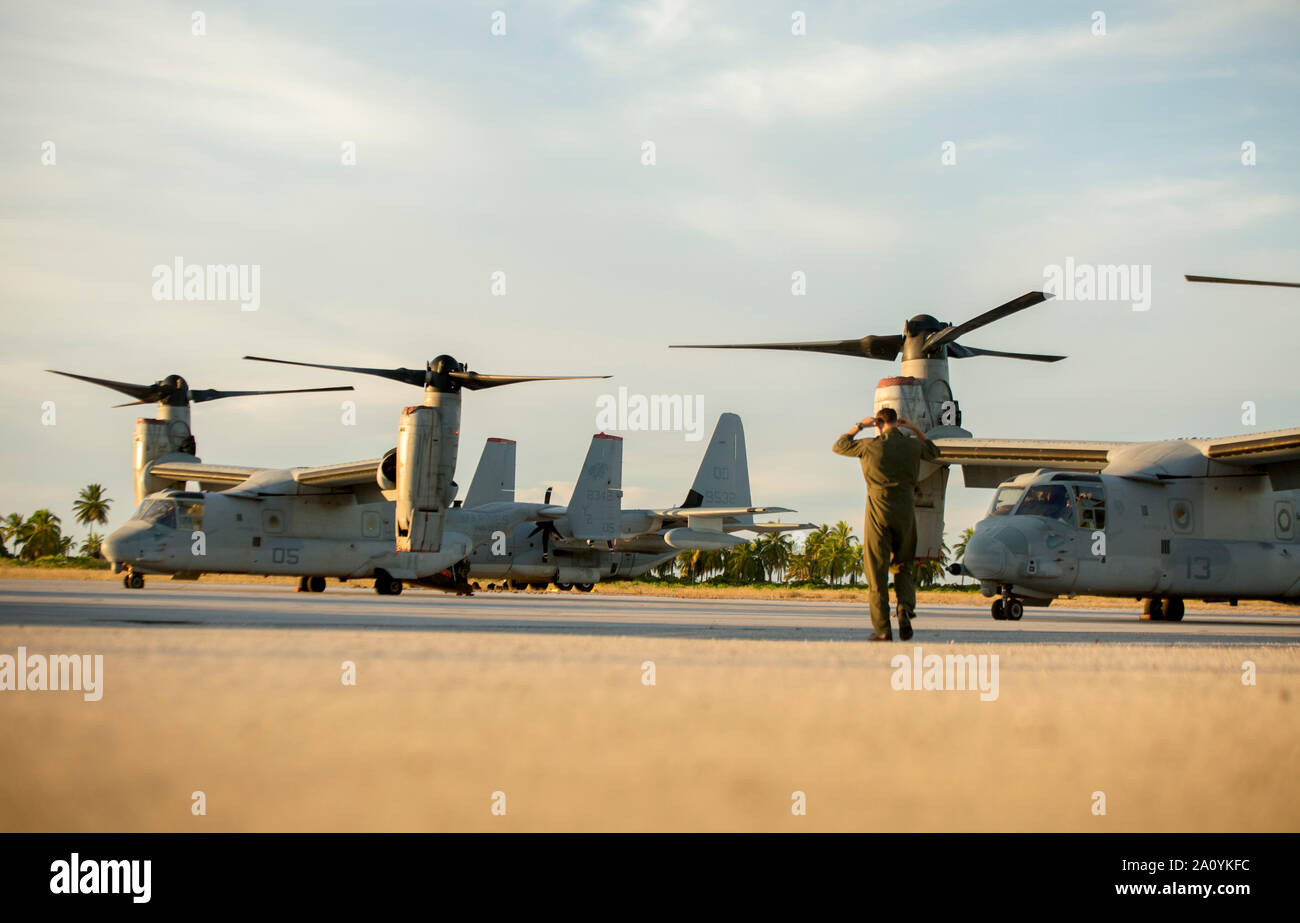A U.S. Marine KC-130J pilot walks towards his parked aircraft during the Marine Rotational Force - Darwin trans-Pacific flight, Cassidy International Airport, Kiribati, Sep. 19, 2019. The flight was conducted to improve upon the Osprey trans-Pacific concept that has been developed and refined over the past three MRF-D iterations. (U.S. Marine Corps photo by 1st Lt. Colin Kennard) Stock Photo