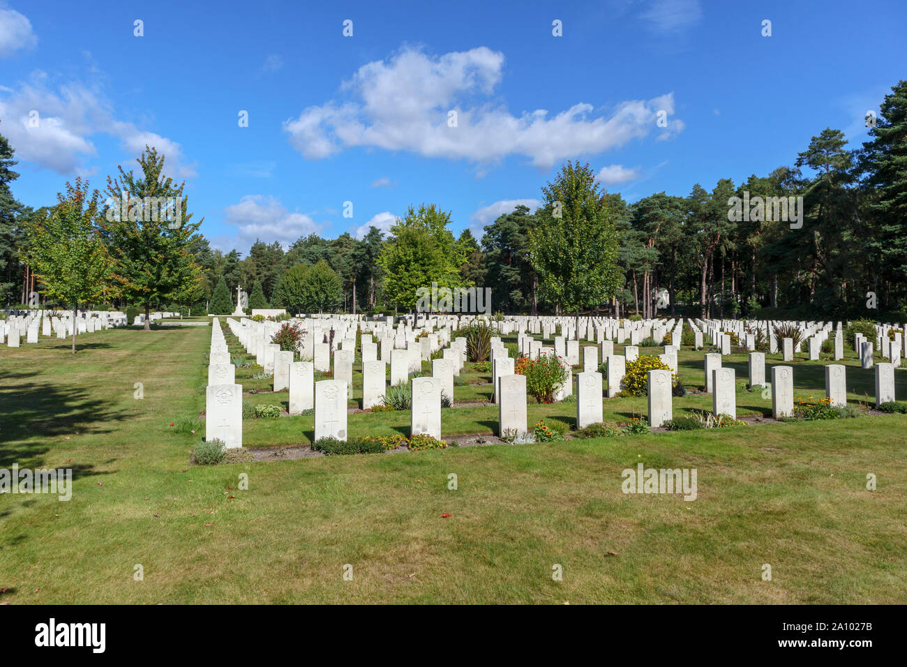 Rows of gravestones and cross in the Canadian Section of the Military Cemetery at Brookwood Cemetery, Pirbright, Woking, Surrey, southeast England, UK Stock Photo