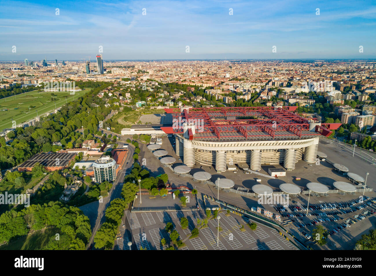 Milan cityscape and the soccer arena Meazza stadium, also known as San Siro Stadium. Aerial panoramic view. Stock Photo