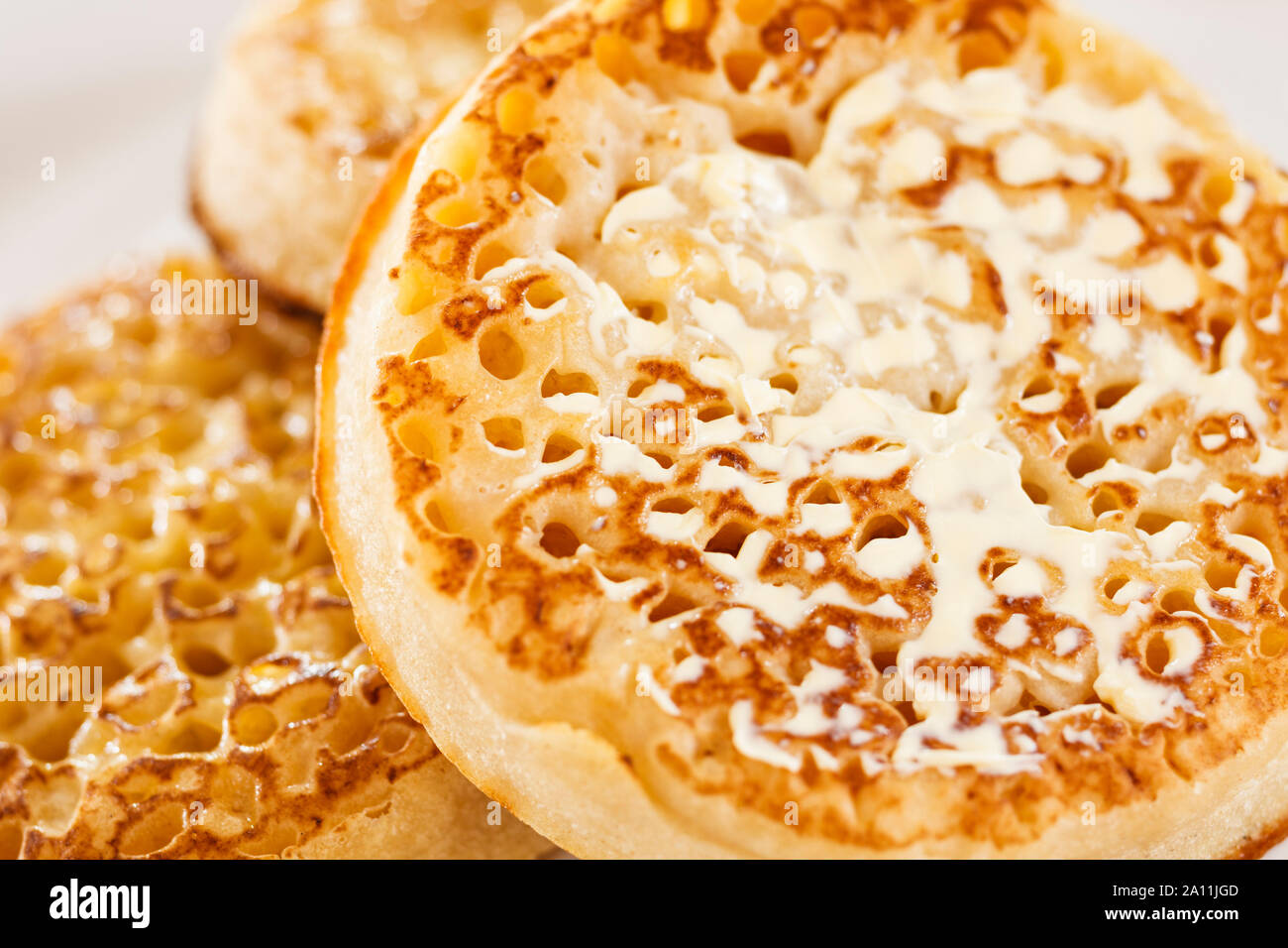 Buttered crumpets, close up Stock Photo