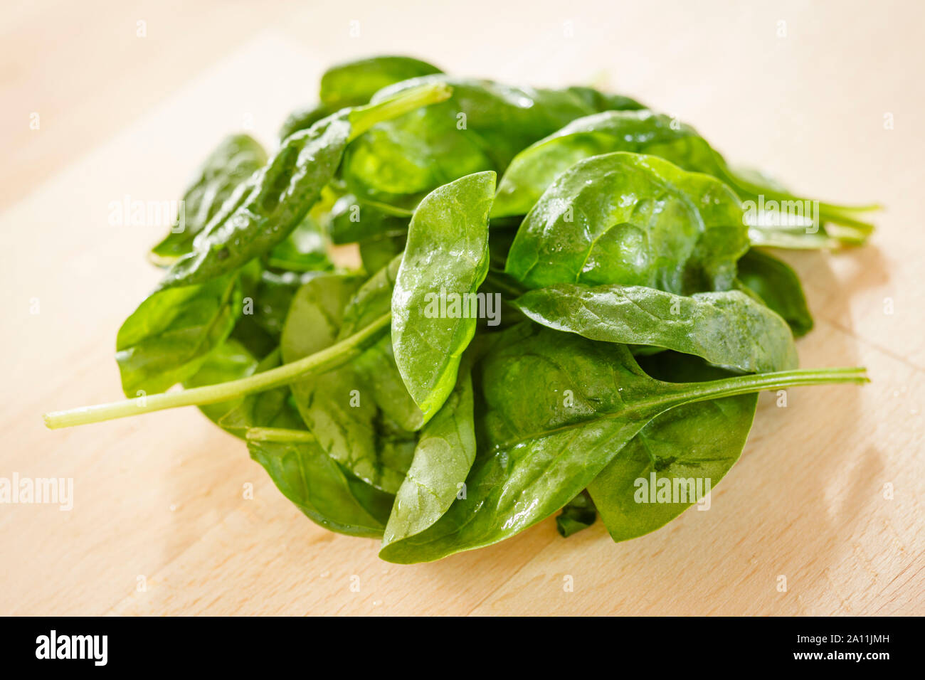 Spinach leaves in a bowl Stock Photo