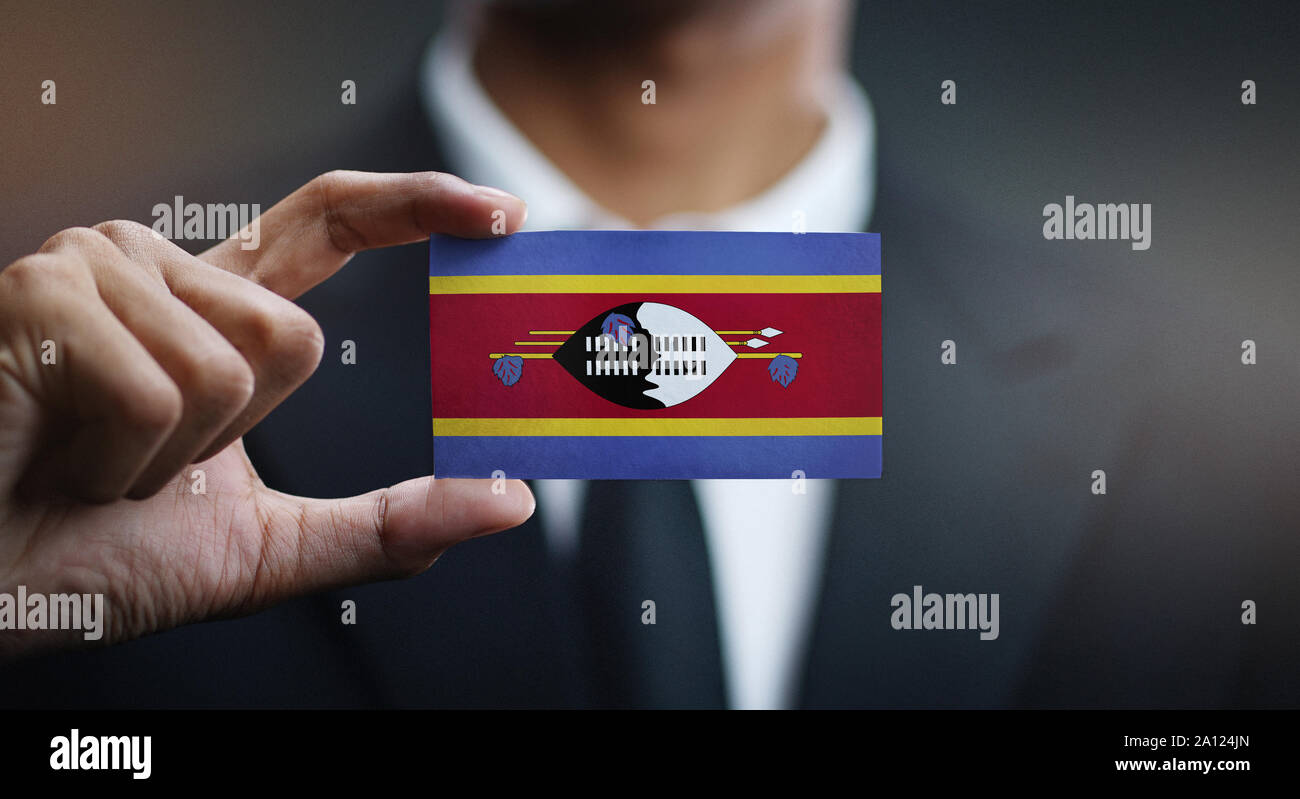 Businessman Holding Card of Swaziland Flag Stock Photo