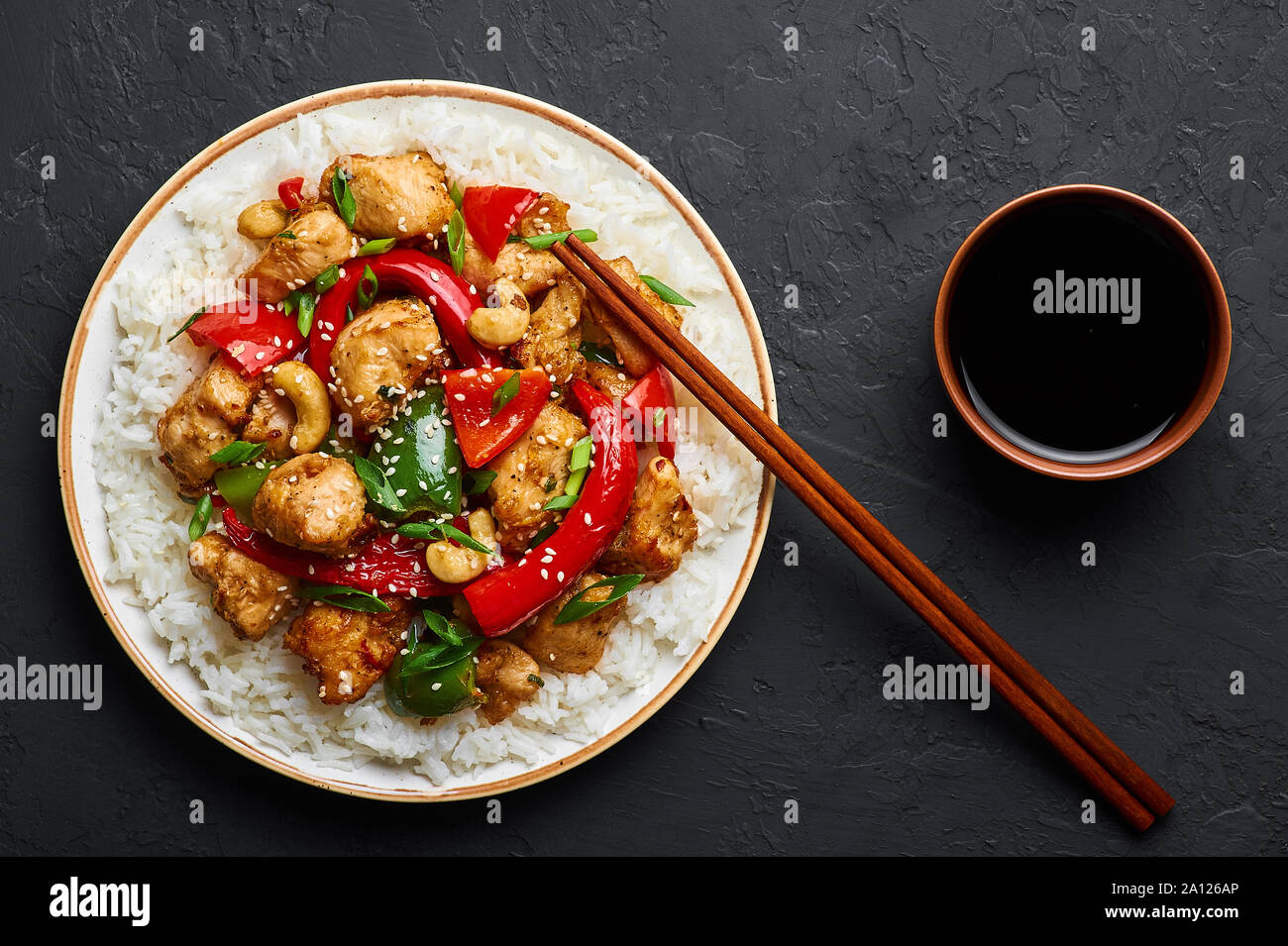 Schezwan Chicken Or Dragon Chicken With Basmati Rice At Black Slate Background Szechuan Chicken Is Popular Indo Chinese Spicy Dish With Chilli Pepper Stock Photo Alamy