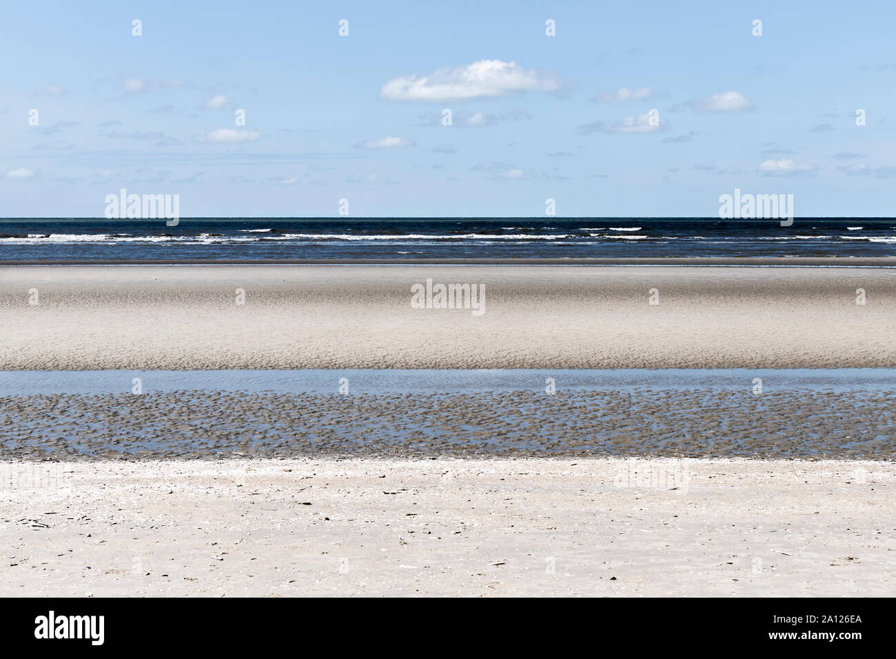 Oostduinkerke, Belgium - July 7, 2019: Layered seascape with blue and yellow tints Stock Photo