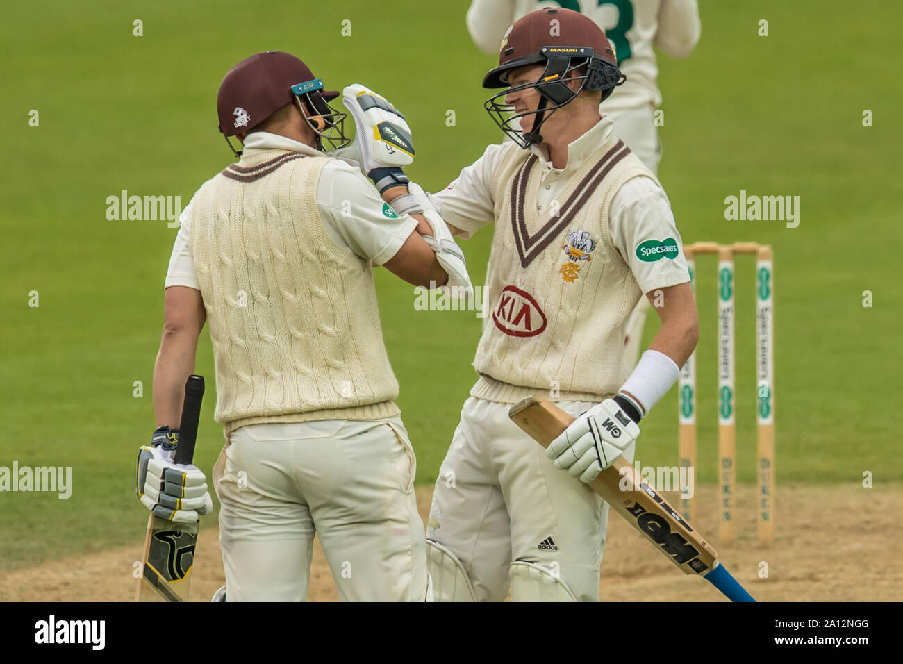 London, UK. 23 September, 2019. Ollie Pope congratulates Scott Borthwick on reaching his 100 batting for Surrey against Nottinghamshire on day one of the Specsavers County Championship game at the Oval. David Rowe/Alamy Live News Stock Photo