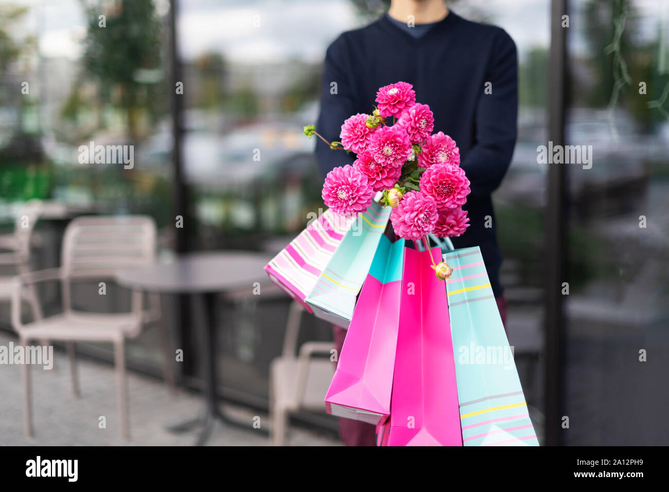 Romantic Man Giving Flowers Bouquet And Bunch Of Pink Gift Bags Near Cafe Ready For Birthday Party Or Romantic Date Copy Space Mother S Women S W Stock Photo Alamy