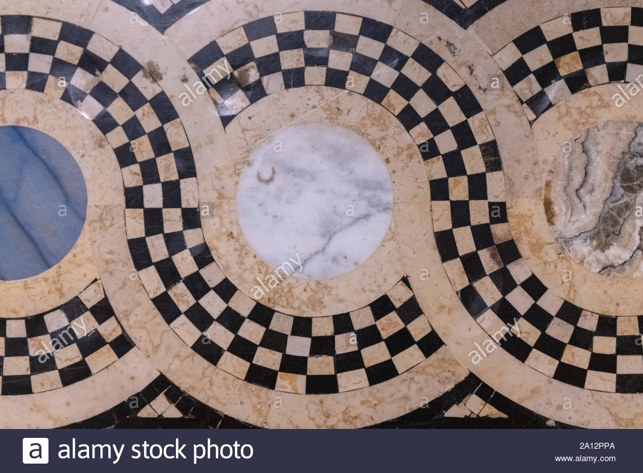 Antique marble floor with a pattern of circles and curves. Beautiful vintage architecture made with valuable stones Stock Photo