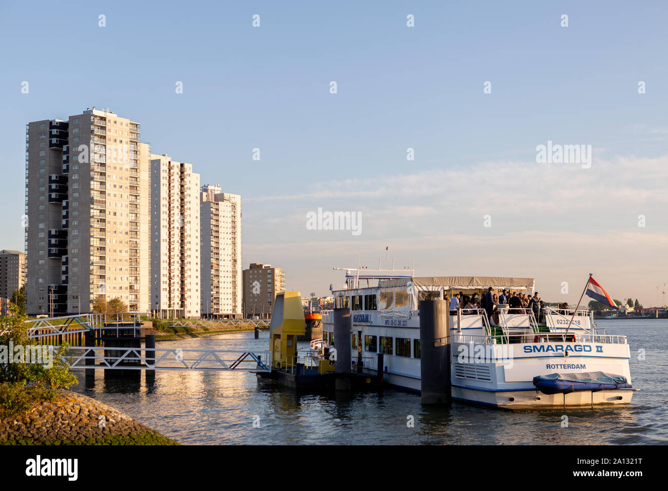 Party boat on the river Maas in the city centre of Rotterdam waiting to depart at sunset Stock Photo