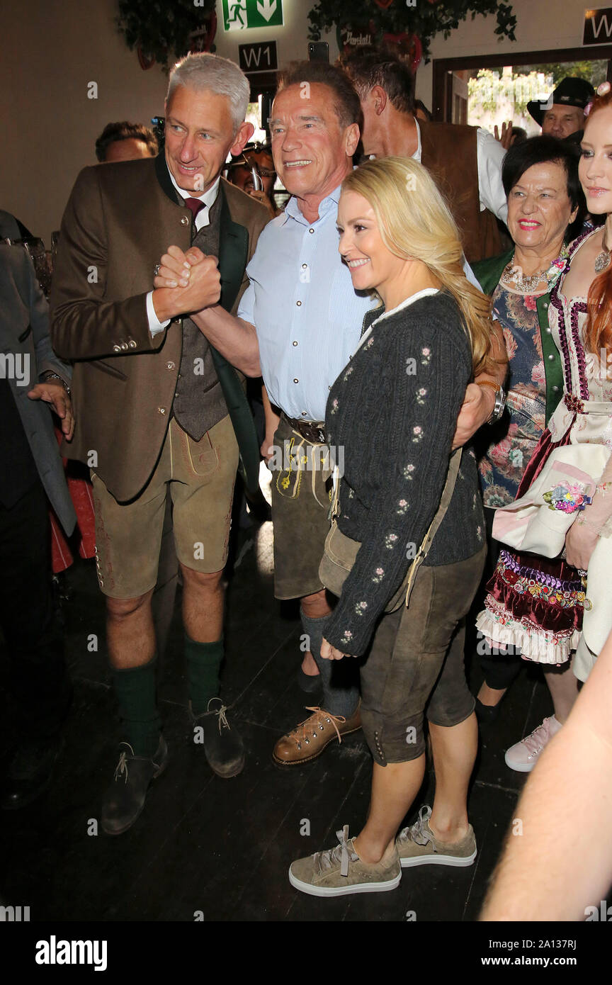 Siegfried Able, Arnold Schwarzenegger and his girlfriend Heather Milligan during the Oktoberfest 2019 at Theresienwiese on September 22, 2019 in Munich, Germany Stock Photo