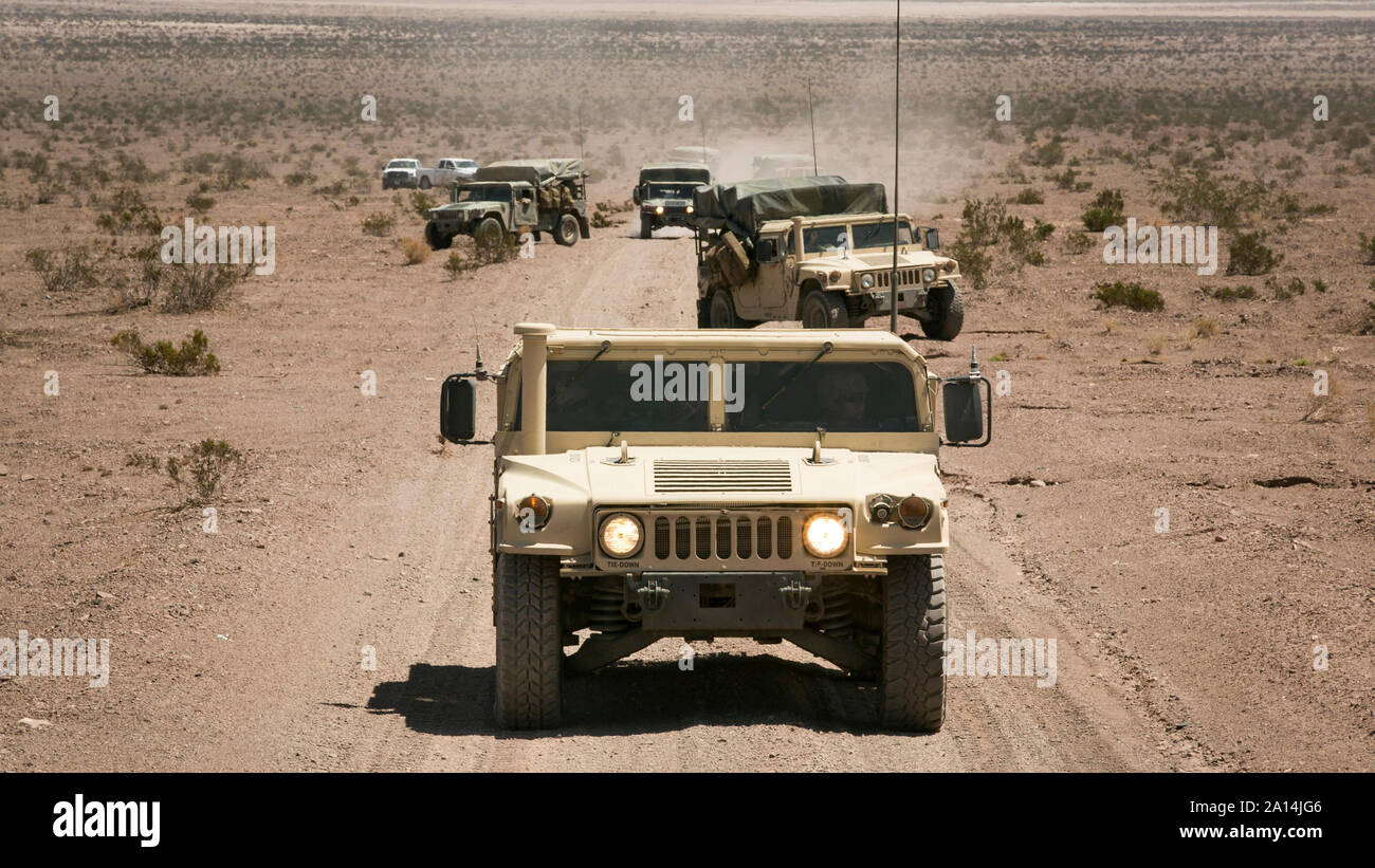 Convoy of humvees at Marine Corps Air Ground Combat Center, California. Stock Photo