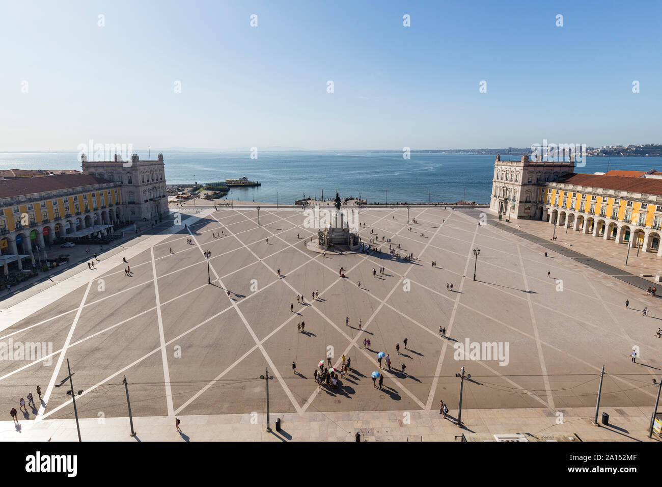 View of Tagus River and people and statue of King Jose I at Praca do Comercio square in Baixa district in Lisbon, Portugal, from above on a sunny day. Stock Photo