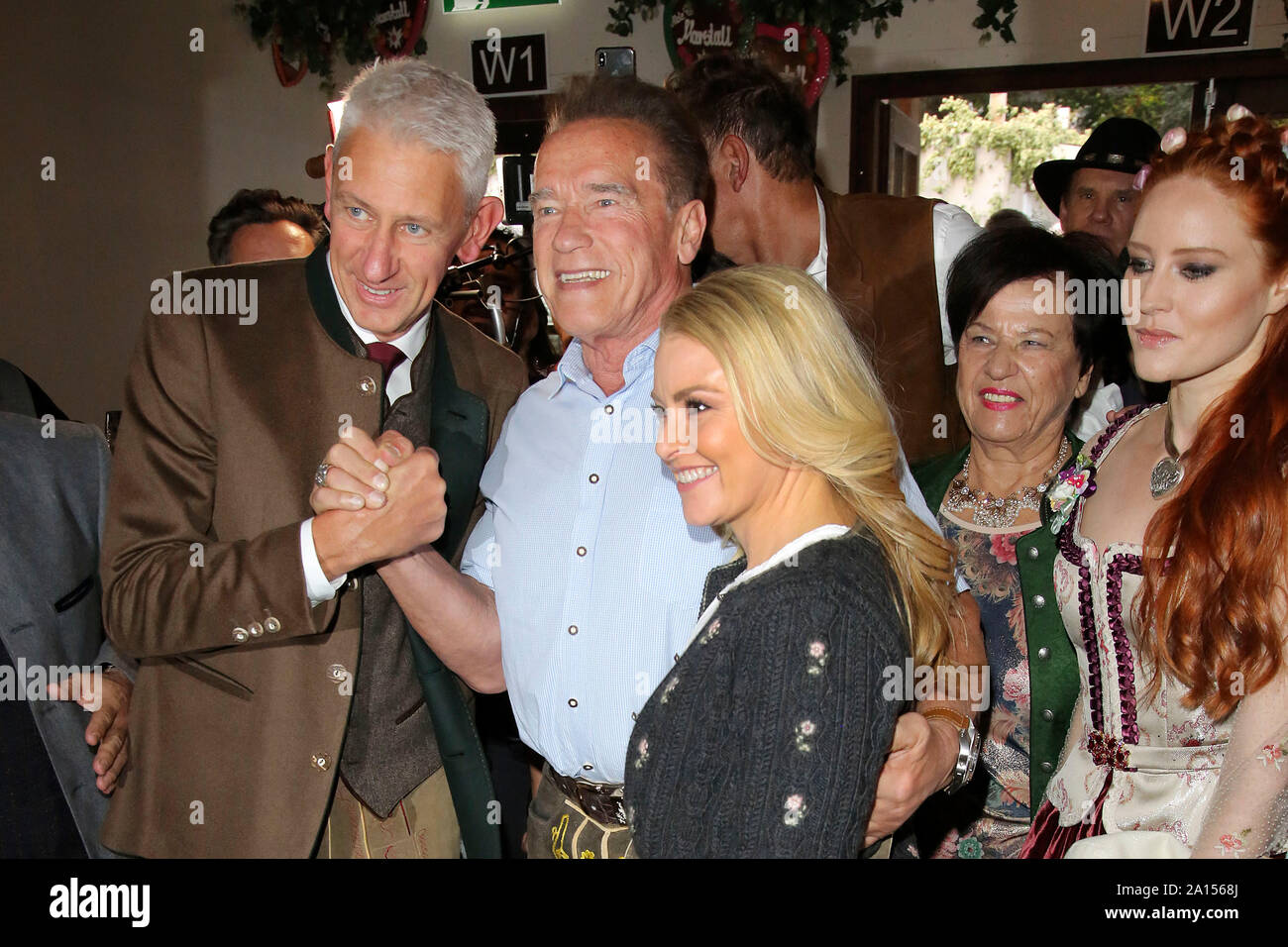 Munich, Deutschland. 22nd Sep, 2019. Siegfried Able and Arnold Schwarzenegger with girlfriend Heather Milligan at the Oktoberfest 2019 in the Marstall Festzelt. Munchen, 22.09.2019   usage worldwide Credit: dpa/Alamy Live News Stock Photo