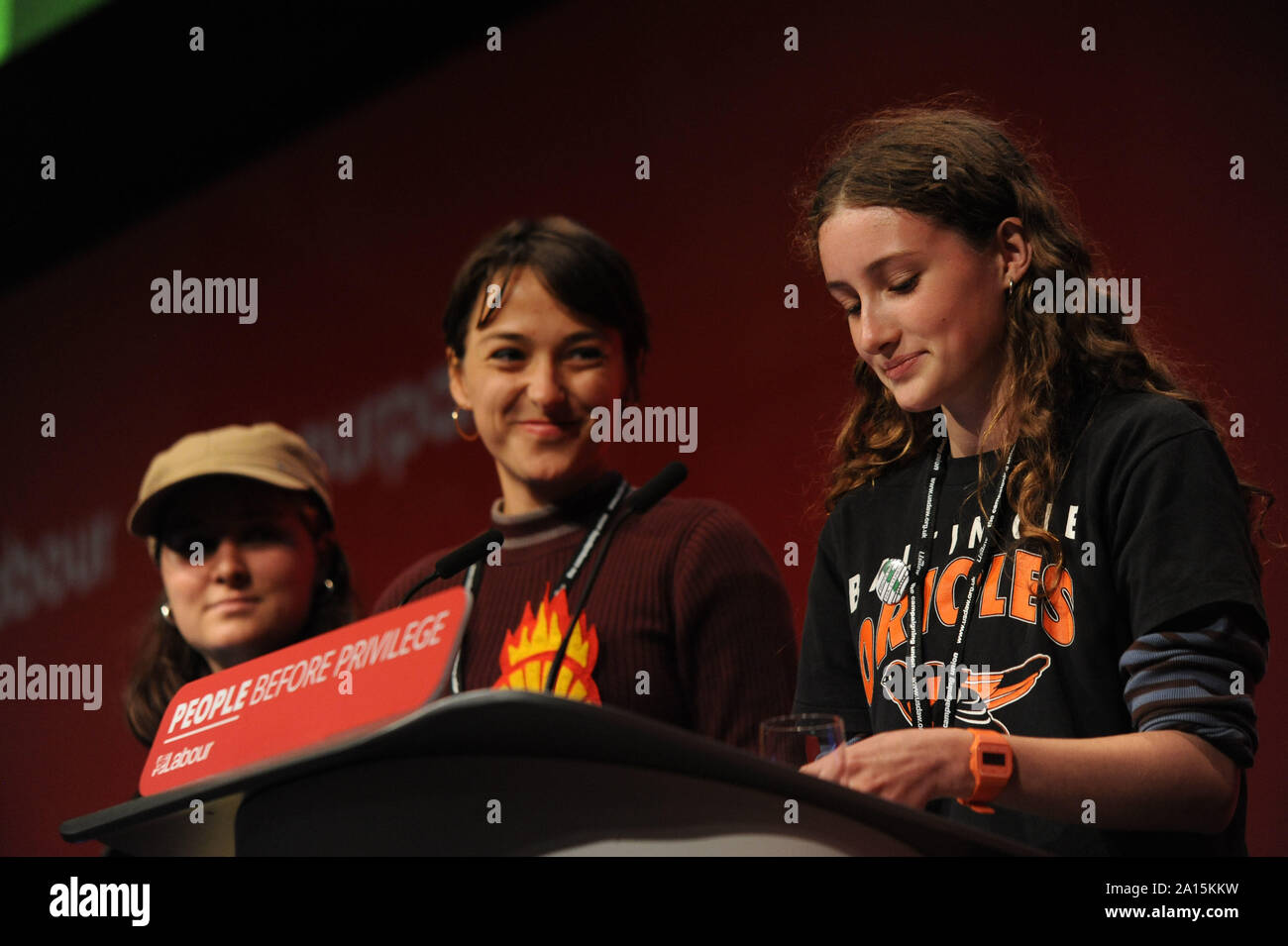Brighton, UK. 24th Sep, 2019. Uma Krieger climate striker, (third from the left) and fellow activists, delivers her speech to delegates in support of the Labour PartyÕs Green New Deal, during the fourth day of the Labour Party annual conference at the Brighton Centre. Credit: Kevin Hayes/Alamy Live News Stock Photo