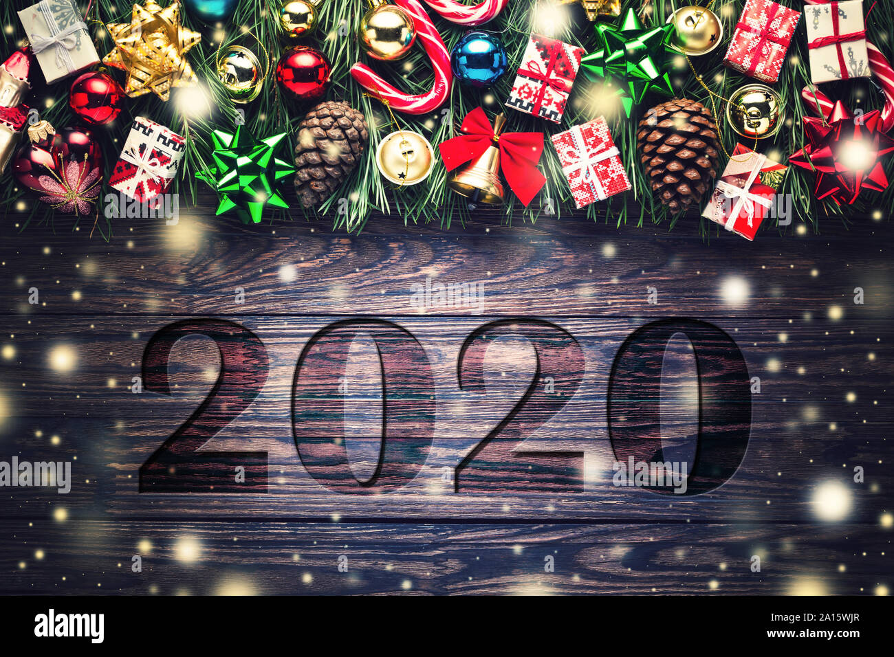 2020 Christmas 2020 New Year and Christmas frame of fir branches and gifts with