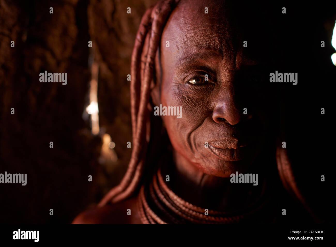 Portrait of an old Himba traditional woman, Oncocua, Angola Stock Photo