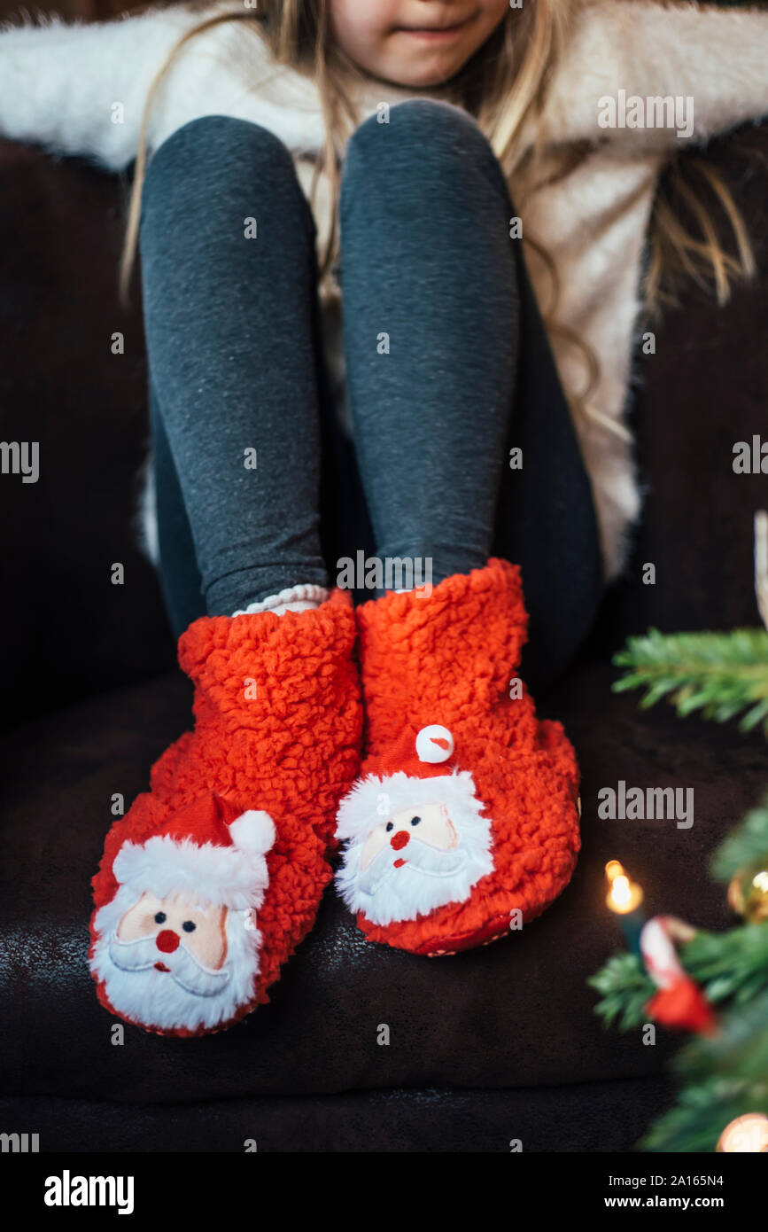 Close-up of girl wearing cozy Santa Claus footwear Stock Photo