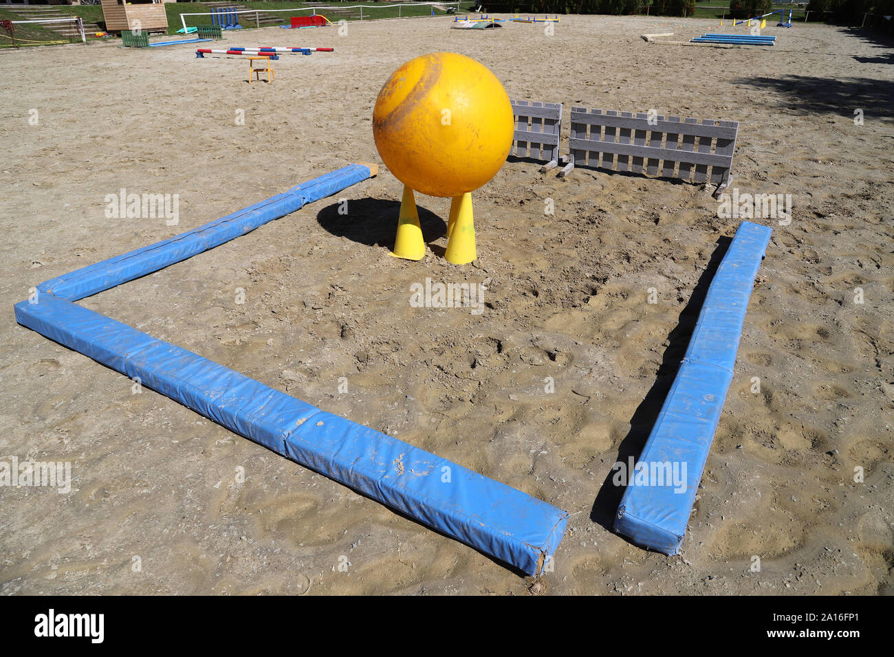 Obstacles for horses in a riding school.Various colorful obstacles for equestrian training Stock Photo