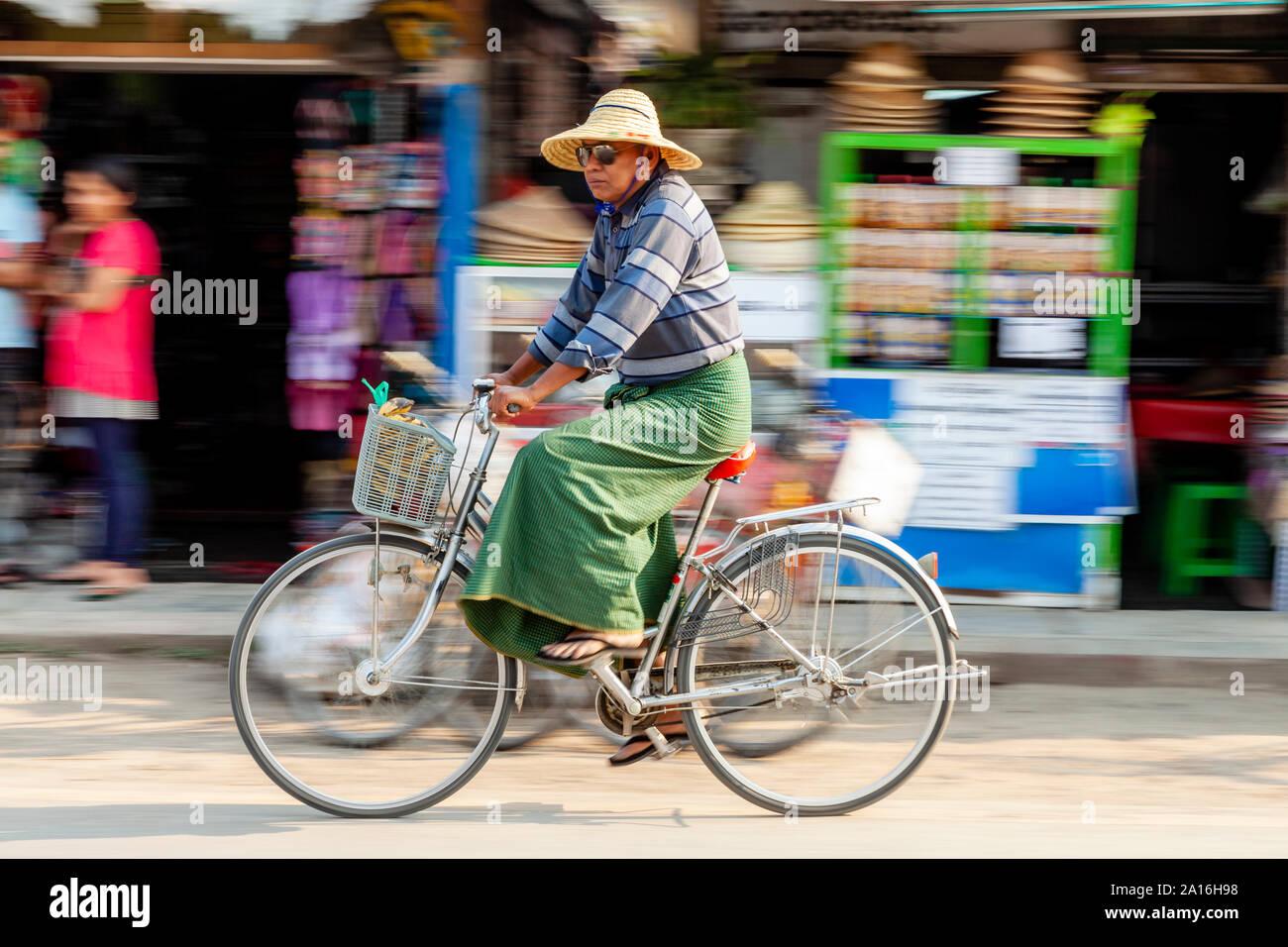 A Senior Burmese Man Wearing A Traditional Longyi Riding A Bicycle Nyaung Shwe Lake Inle Shan State Myanmar Stock Photo Alamy