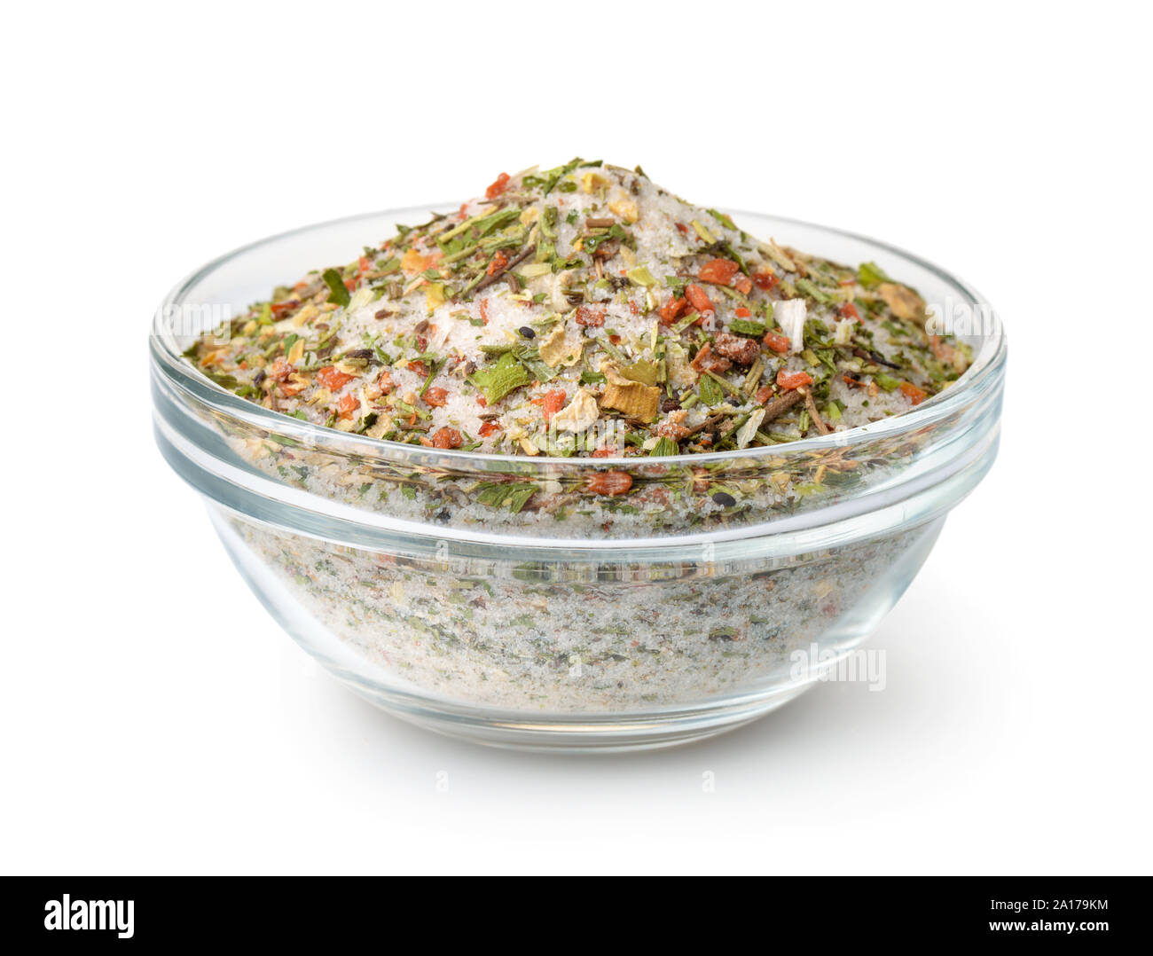 Bowl of mixed aromatic salt, spices and herbs isolated on white Stock Photo