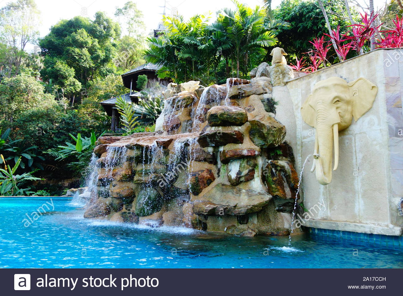 Beautiful turquoise swimming pool with waterfall rocks ...