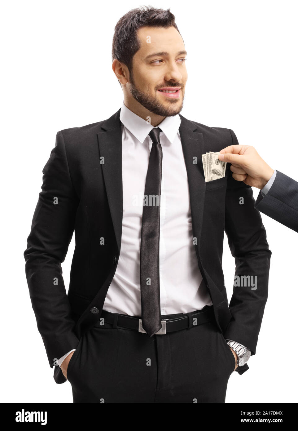 Male hand putting money in a businessman's suit pocket isolated on white background Stock Photo