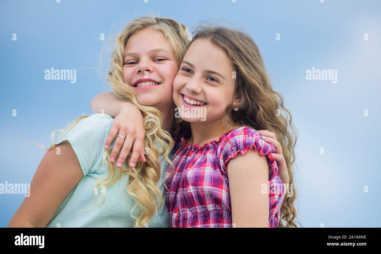Curly And Gorgeous Hairstyles Beautiful Sisters Hairdresser Salon Services Two Little Girls Kids With Long Curly Hair Girls With Healthy Natural Curly Hair Beauty Procedure Adorable Kids Stock Photo Alamy