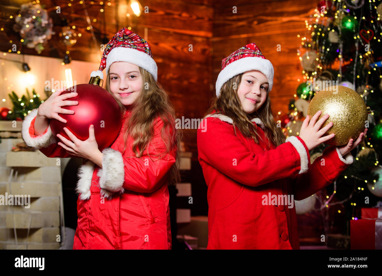 Festive Atmosphere Christmas Day Togetherness Concept Decorate Christmas Tree Together Girls Sisters Santa Claus Costumes Kids Lovely Friends Meet Christmas Holiday Family Celebrate Christmas Stock Photo Alamy