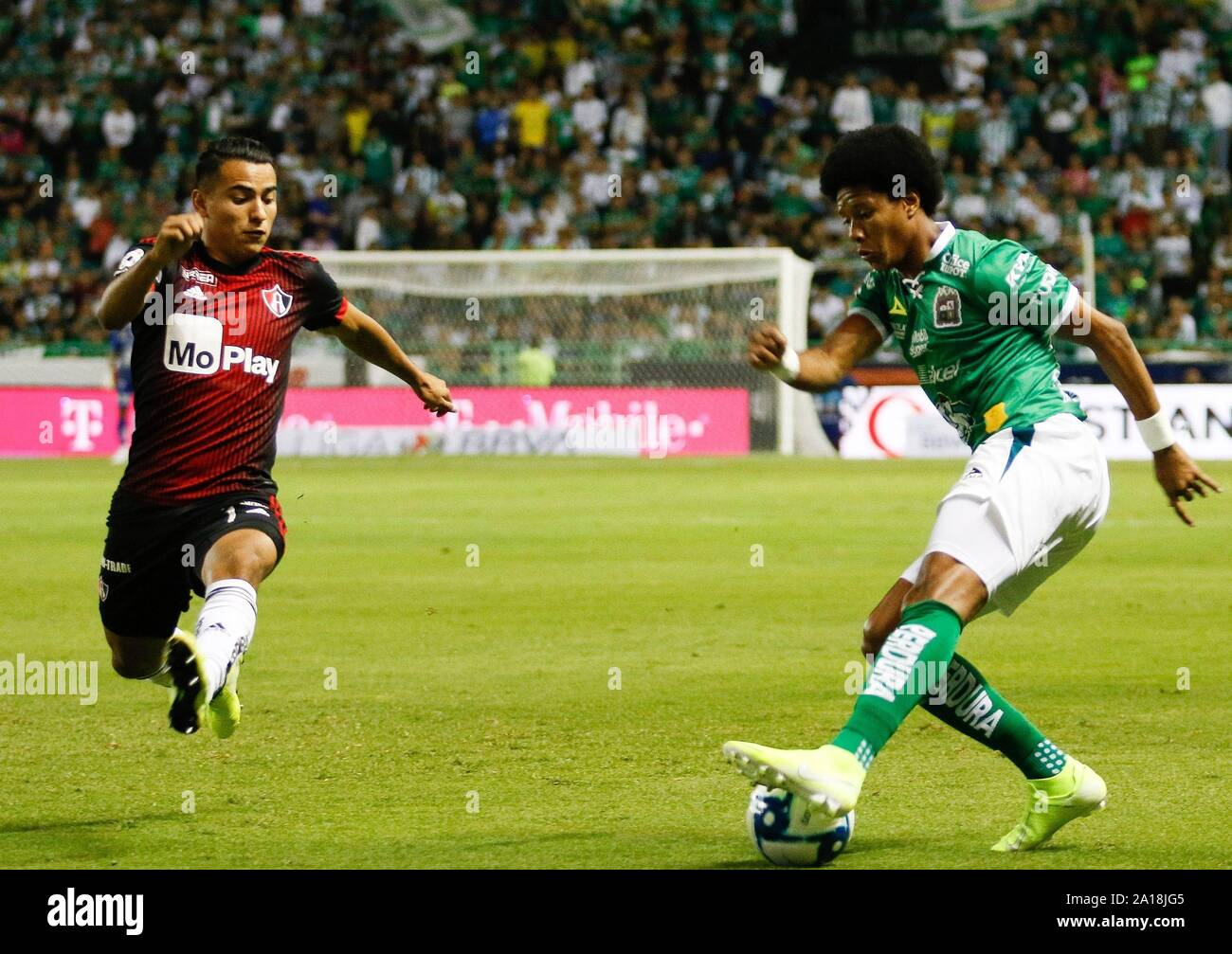 Leon, Mexico. 25th Sep, 2019. Leon's defender Yairo Moreno (R) in action  against Atlas' defender Brayton Vazquez (L) during a mexican soccer league  match at the Nou Camp Stadium in Leon, Mexico,