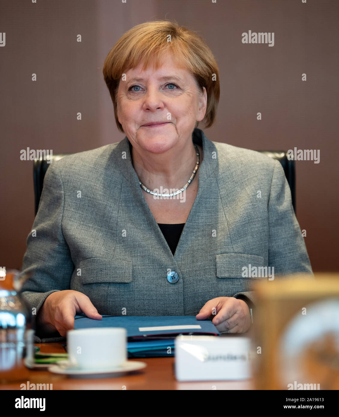 Berlin, Germany. 25th Sep, 2019. Chancellor Angela Merkel (CDU) sits in the Chancellor's Office at the beginning of the cabinet meeting. After the coalition leaders and the climate cabinet, the entire cabinet is now dealing with the cornerstones of climate protection. Credit: Bernd von Jutrczenka/dpa/Alamy Live News Stock Photo