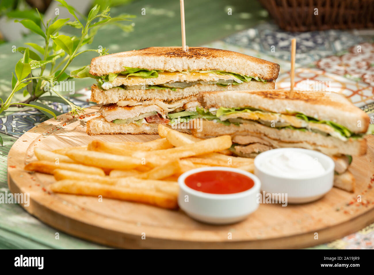 Classic chicken club sendwich with french fries Stock Photo