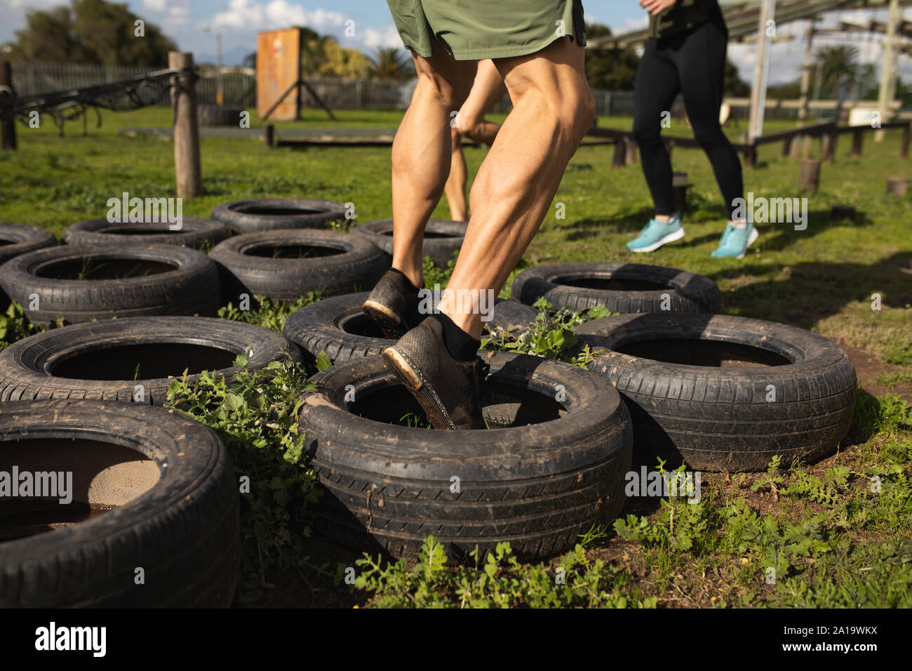 Young man training at an outdoor gym bootcamp Stock Photo