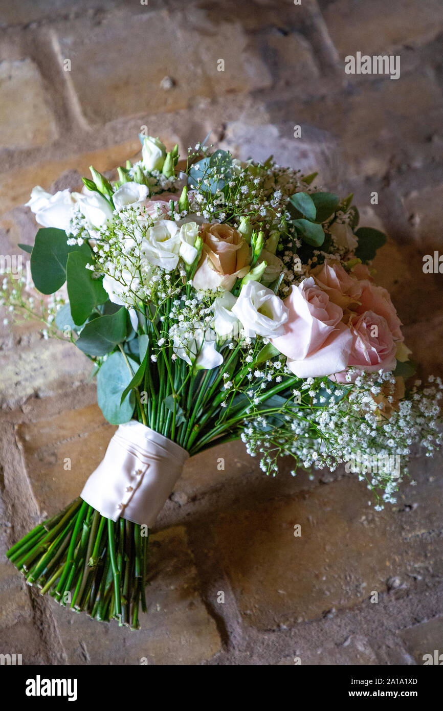 A Bride S Bouquet Made With Roses Eucalyptus And Gypsophila Stock Photo Alamy