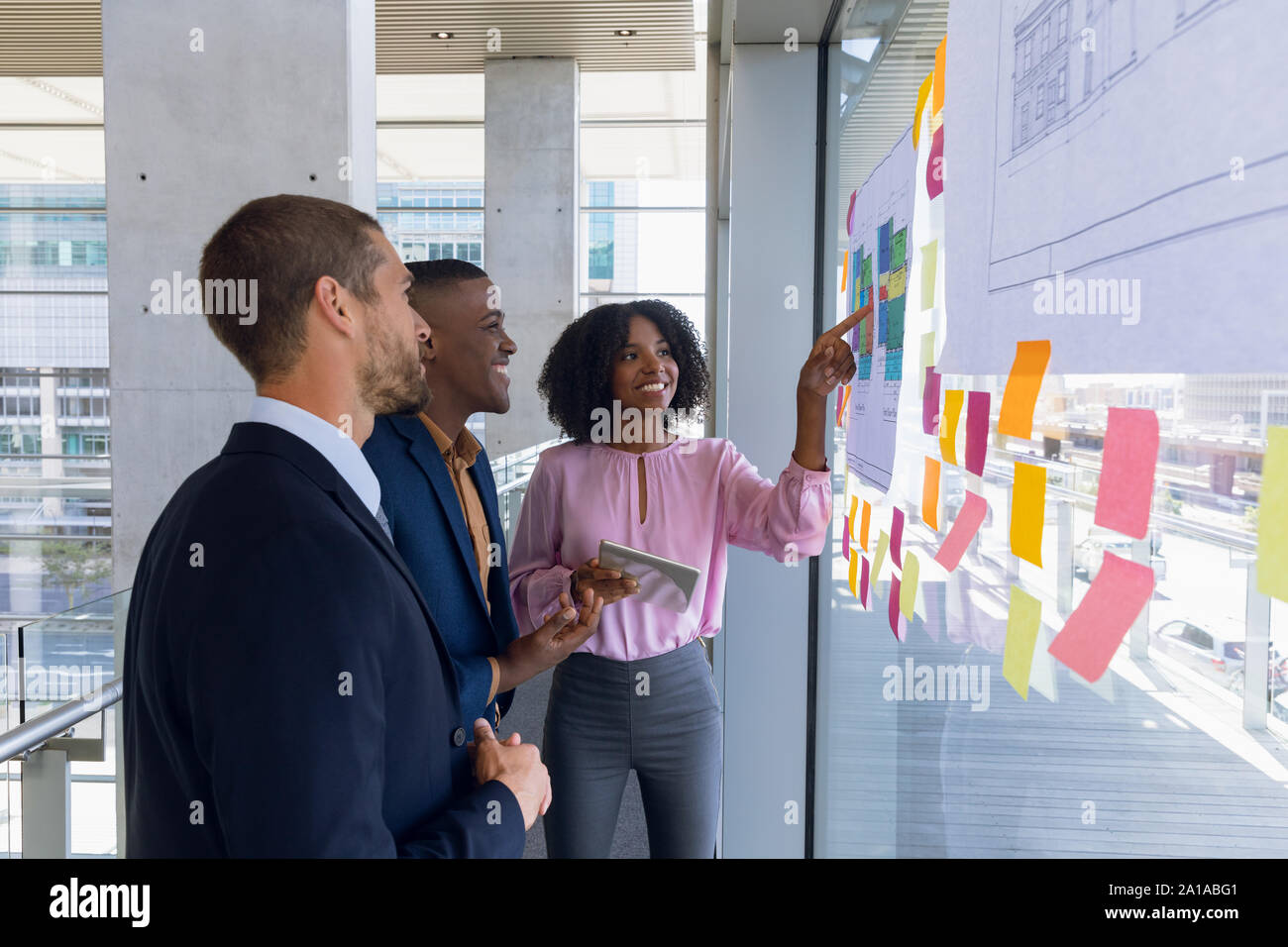 Young business people working in modern office Stock Photo