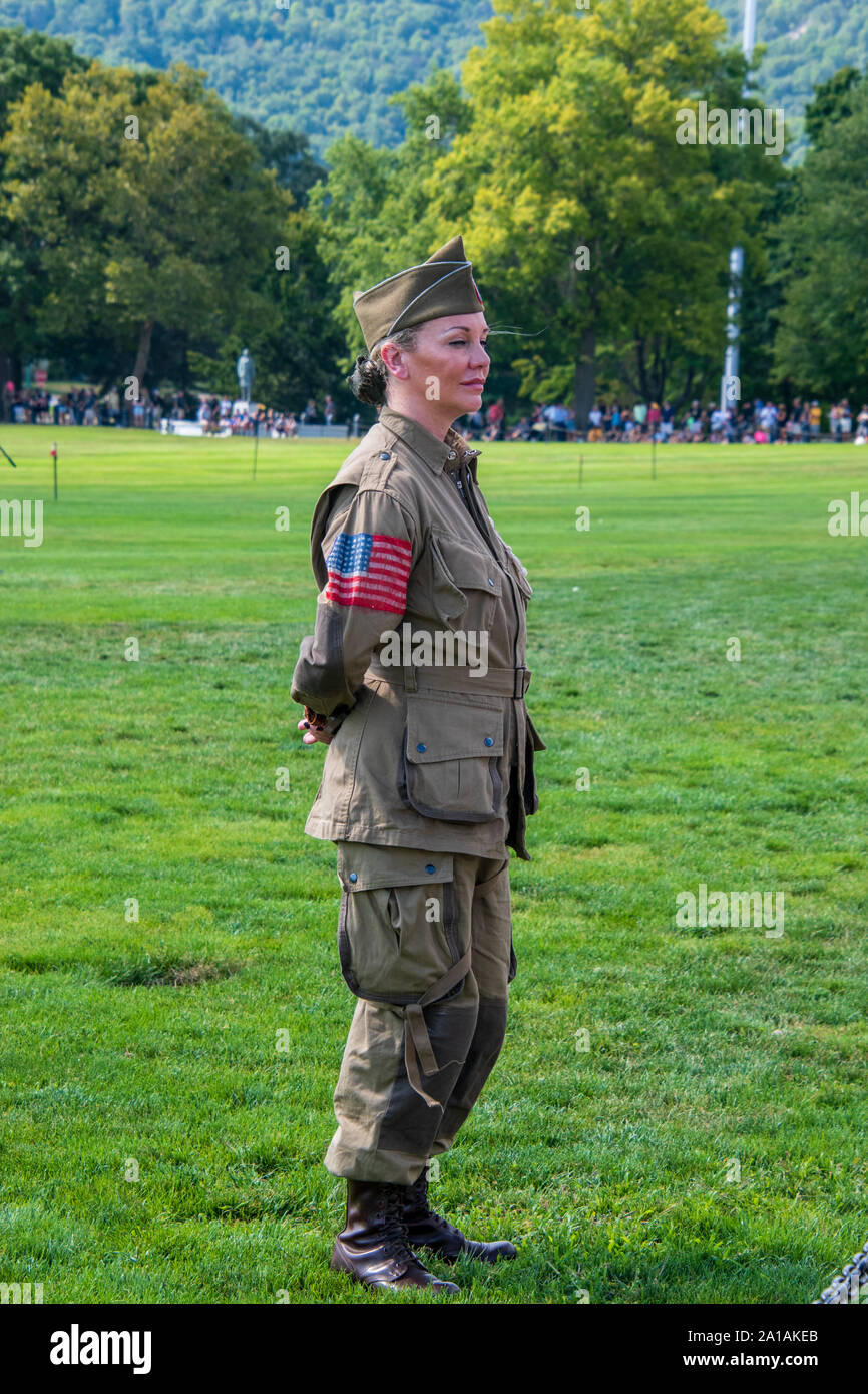 West Point, New York - August 30, 2019: Pretty young woman in military uniform stands at rest on a grassy field Stock Photo