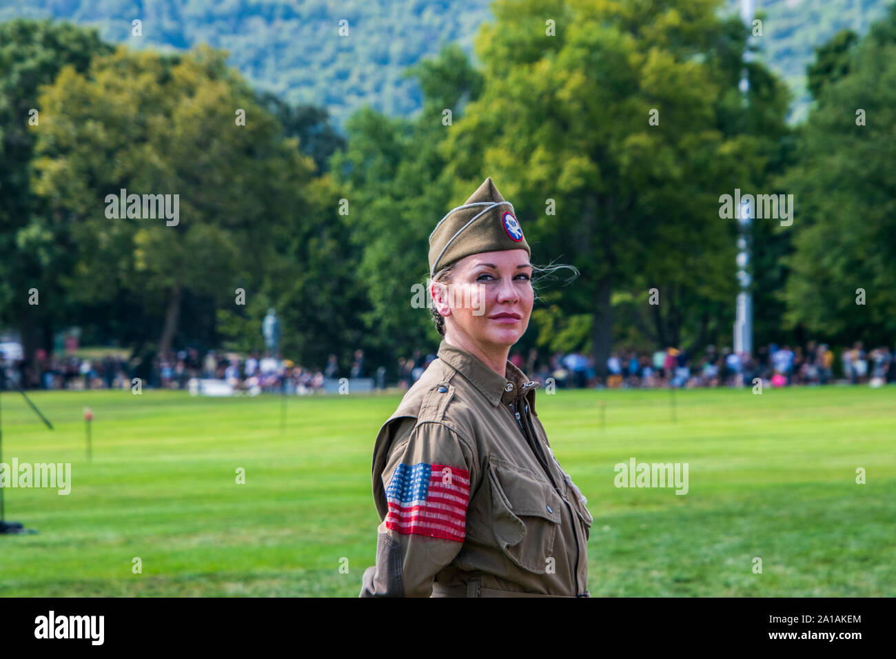 West Point, New York - August 30, 2019: Close up of a pretty young woman in military uniform. There is a grassy field with trees in the background Stock Photo