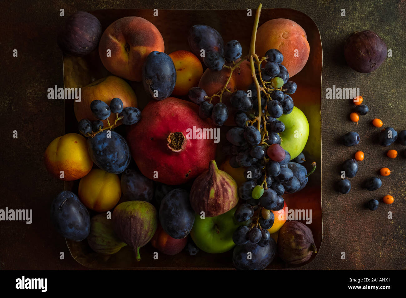 Variety Of Colourful Autumn Fruits Pomegranate Grapes Peaches Plums Apples Figs On Square Platter On Dark Background Horizontal Image Top View Stock Photo Alamy