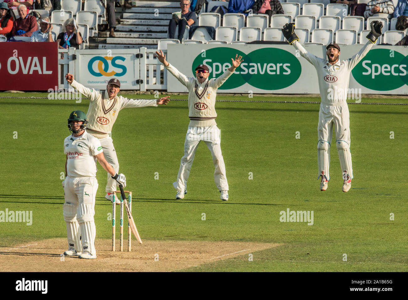 London, UK. 25 September, 2019. The fielders appeal and Rikki Clarke has Steven Mullaney LBW bowling for Surrey against Nottinghamshire on day three of the Specsavers County Championship game at the Oval. David Rowe/Alamy Live New Stock Photo