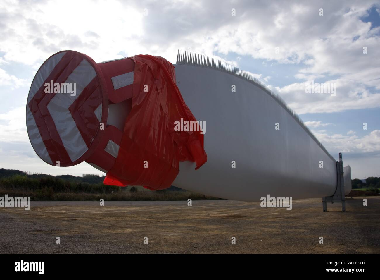 Wind turbine blades poised for distribution to new wind turbine sites throughout the region of northern France Stock Photo