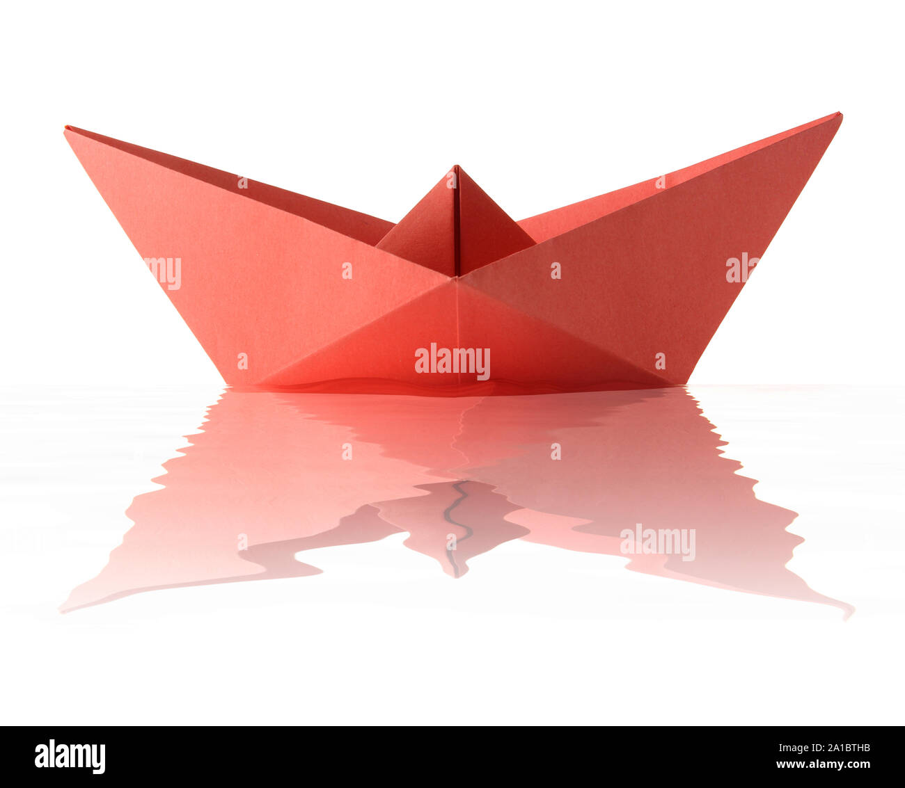 Origami red boat Stock Photo