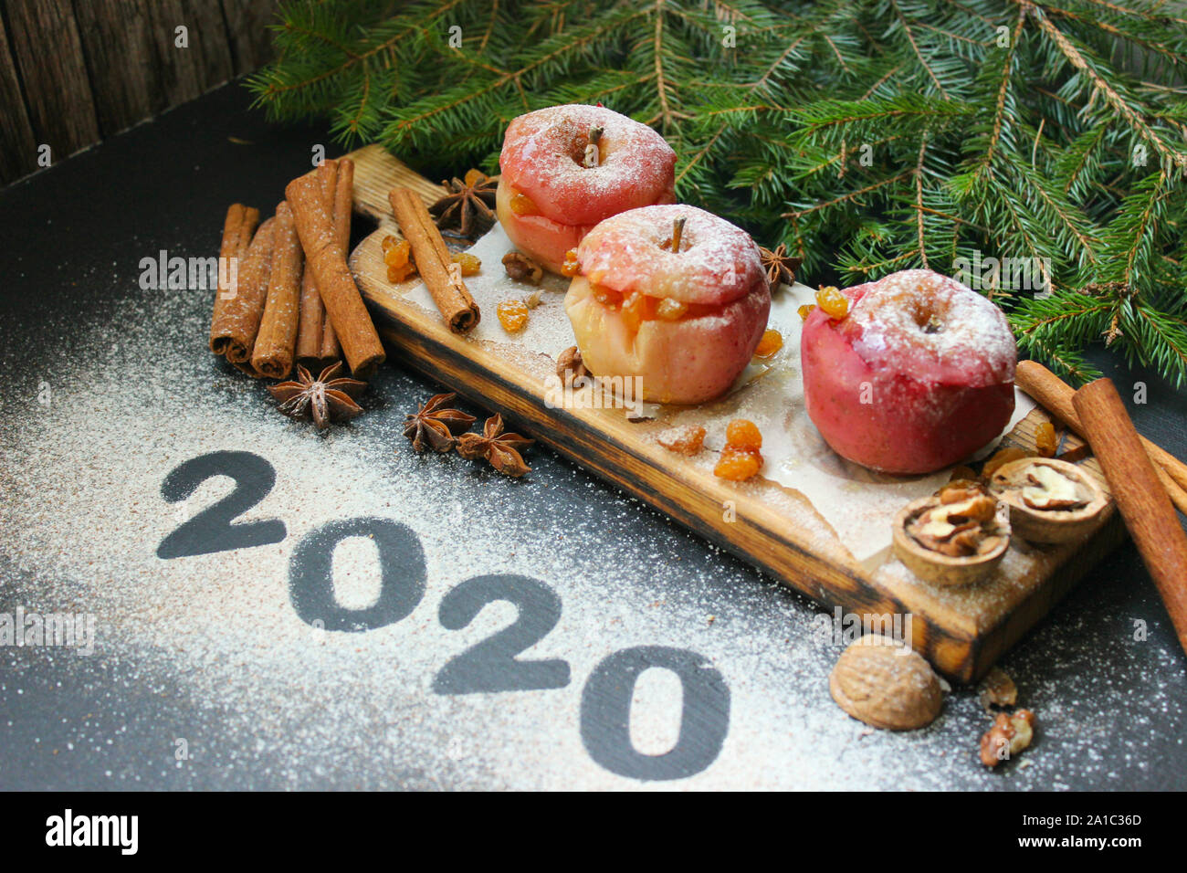 Apple Christmas 2020 New year 2020, numbers written in flour on table. baked apple with
