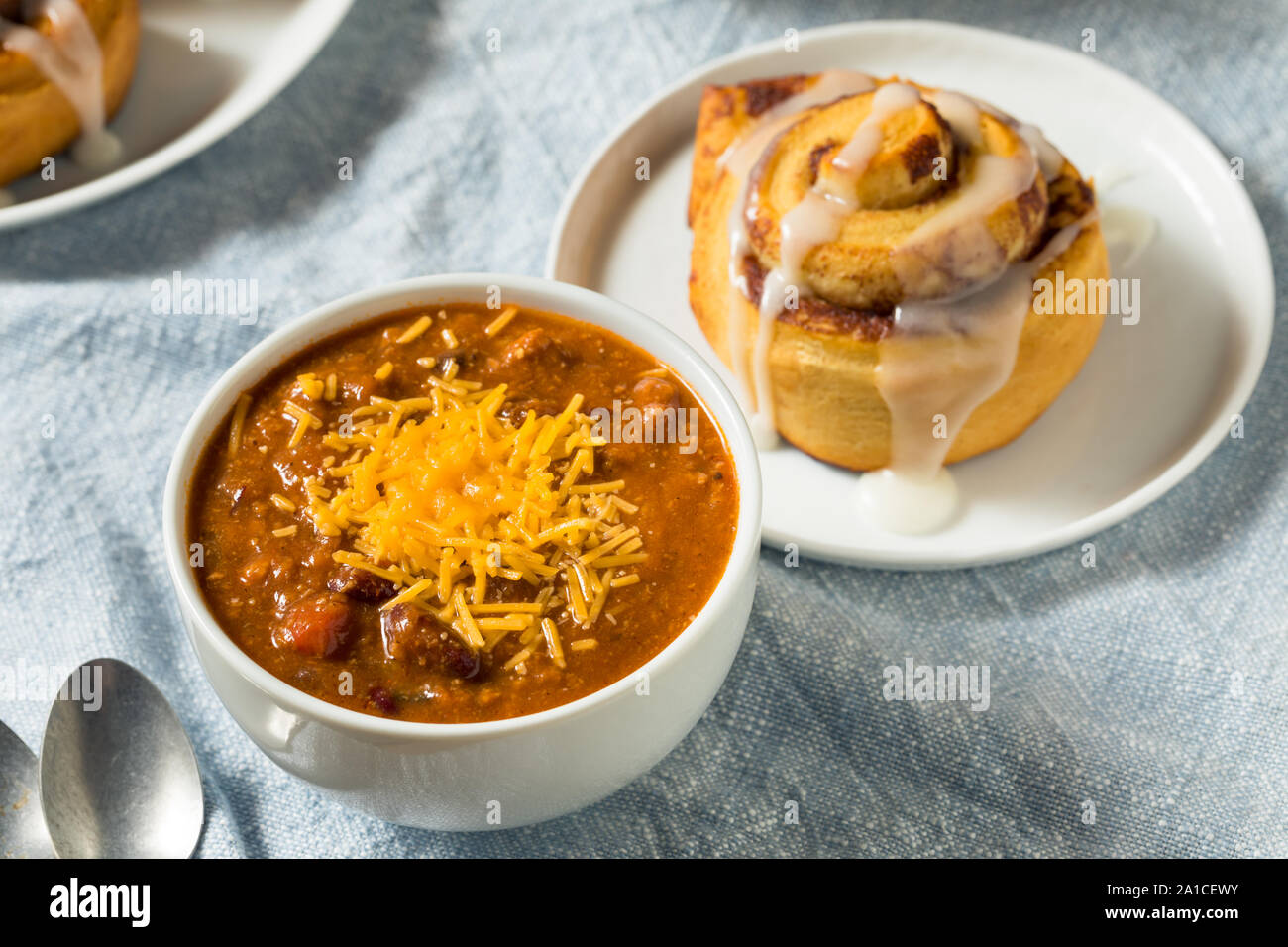 Homemade Chili Soup And Cinnamon Roll For Lunch Stock Photo Alamy