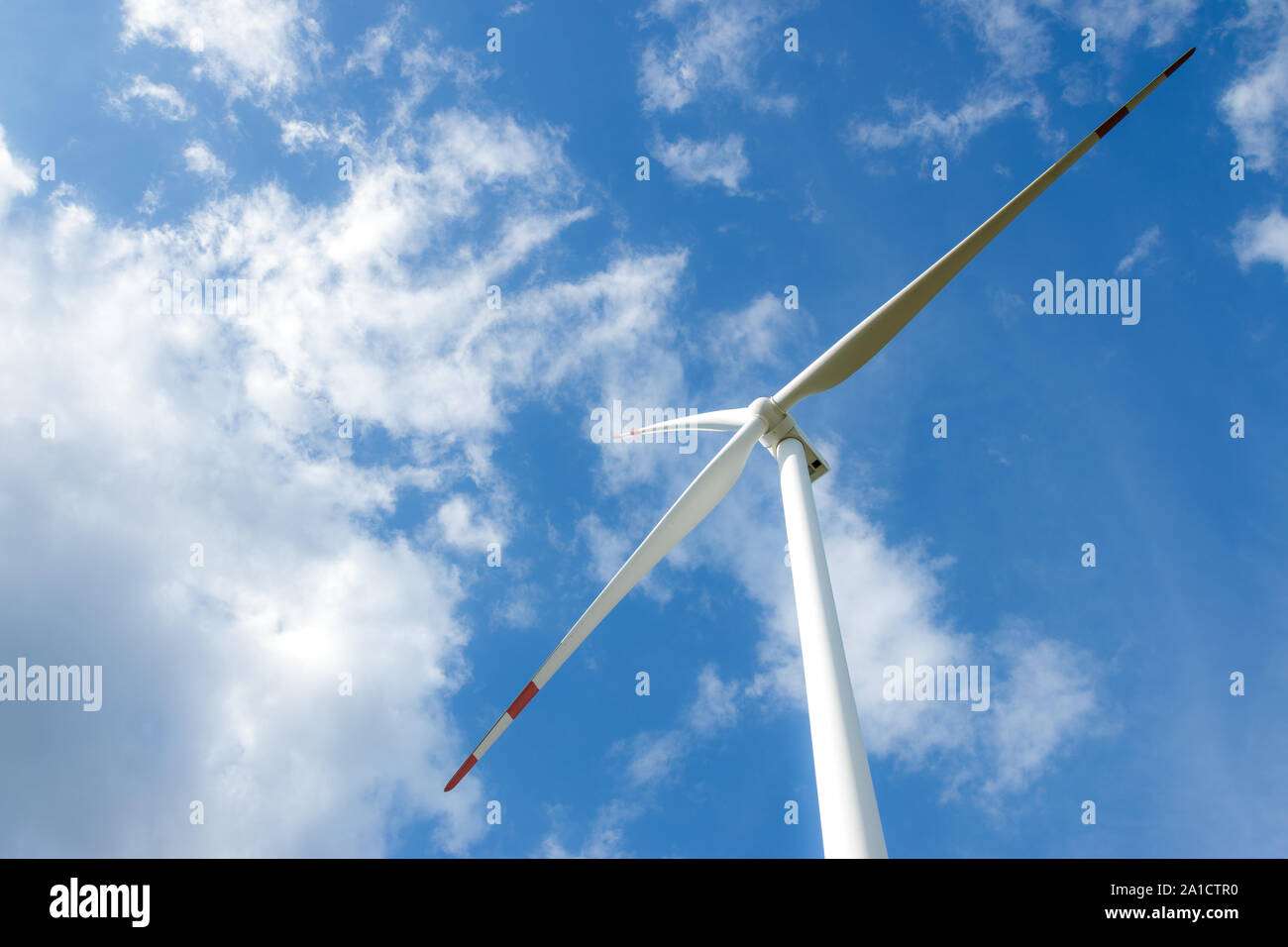 Wind turbine farm power generator in beautiful nature landscape for production of renewable green energy is friendly industry to environment. Stock Photo