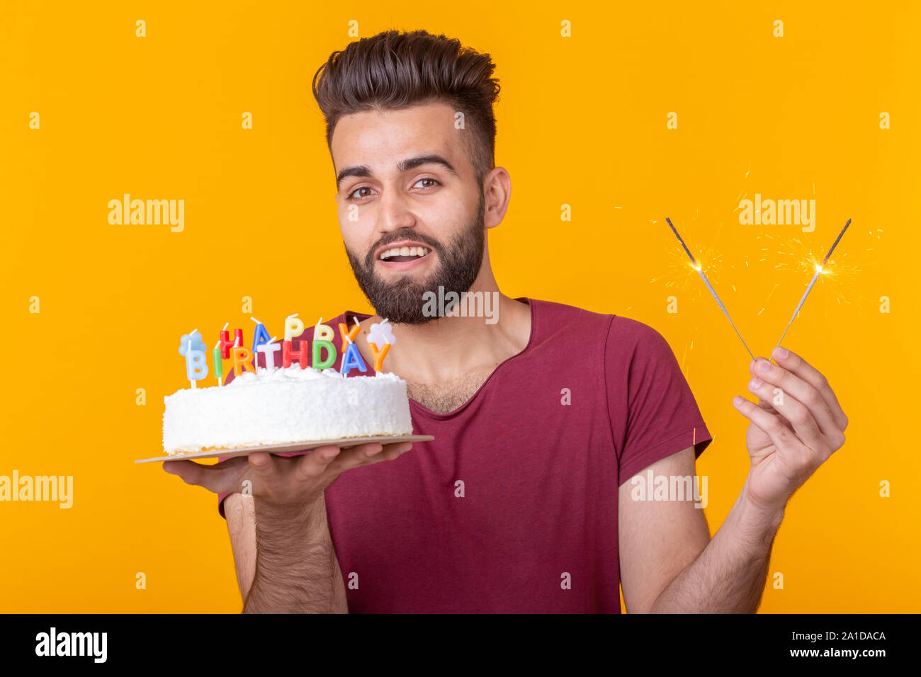 Excellent Positive Young Man Holding A Happy Birthday Cake And Two Burning Birthday Cards Printable Giouspongecafe Filternl