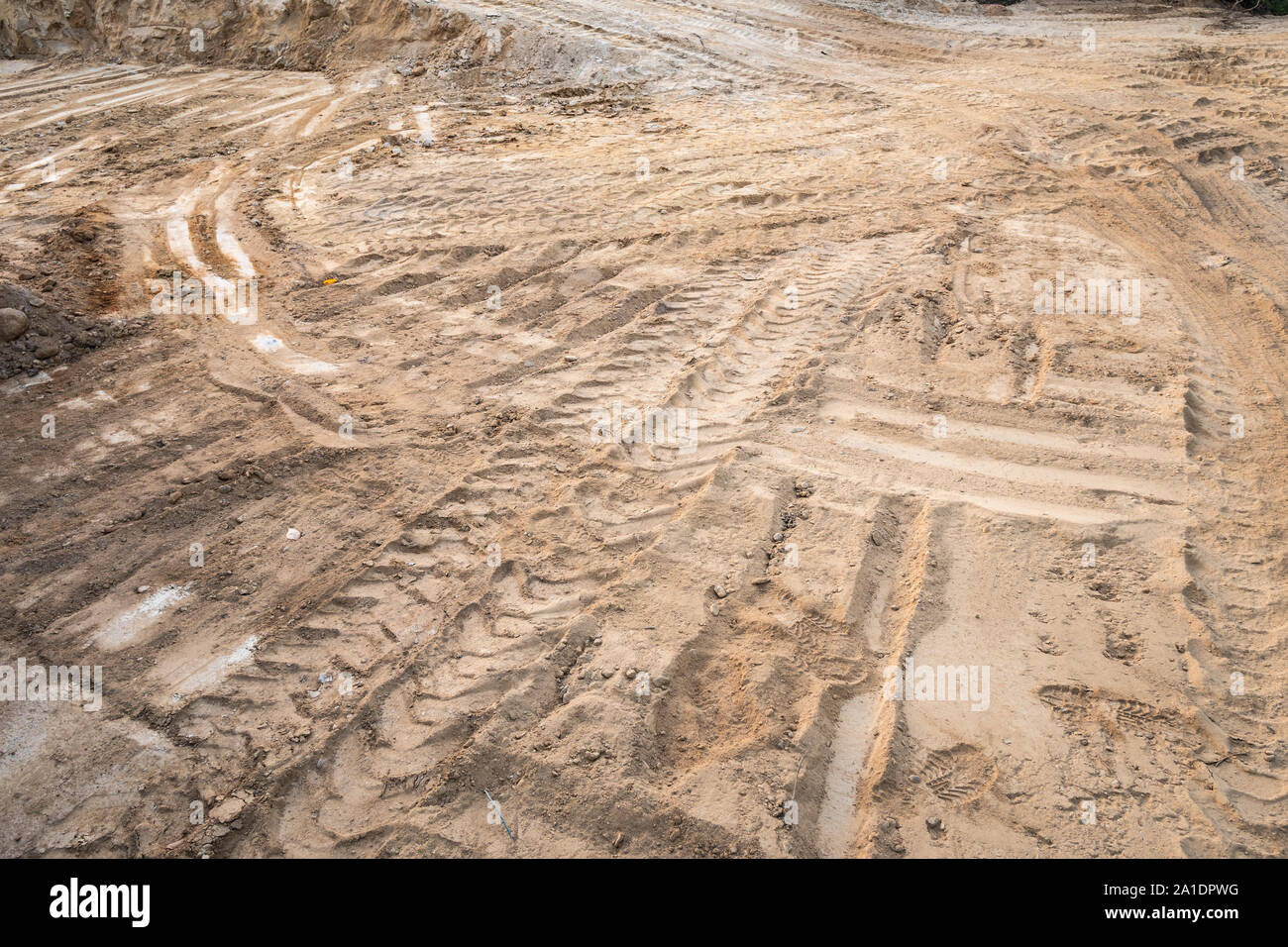 Construction background with dirt soil and tire tracks. Construction Working site Stock Photo