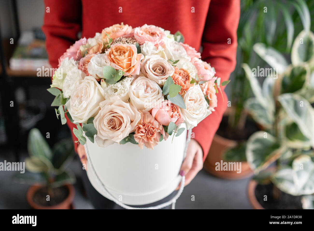 Cute Floral Arrangement Of Mixed Flowers In Woman Hand Round Box The Work Of The Florist At A Flower Shop Delicate Pastel Color Fresh Cut Flower Stock Photo Alamy